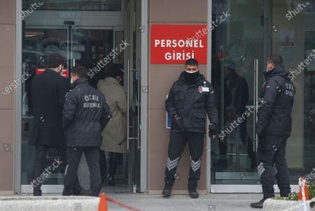 Security personnel guard the entrance to Istanbul's court, where the case of a Turkish private airline official and two pilots over their involvement in former Nissan Motor Co. chairman Carlos Ghosn's dramatic escape out of Japan in 2019 and to Beirut, Lebanon, was held. The court convicted a Turkish private airline official and two pilots and sentenced them each to four years and two months in prison. Ghosn, who was arrested over financial misconduct allegations in Tokyo in 2018, skipped bail while awaiting trial there