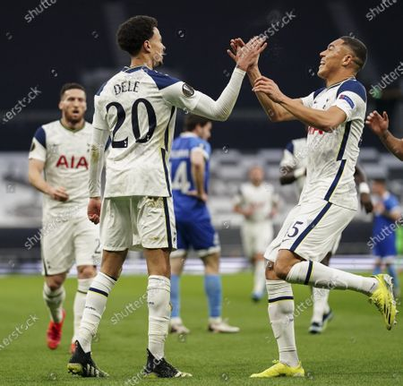 Dele Alli of Tottenham Hotspur celebrates scoring the opening goal with Carlos Vinicius of Tottenham Hotspur