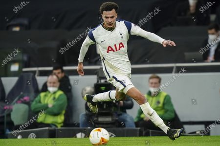 Dele Alli of Tottenham Hotspur runs the ball