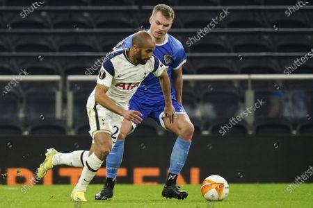 Stock Image of Lucas Moura of Tottenham Hotspur runs the ball past Gustav Henriksson of Wolfsberger AC