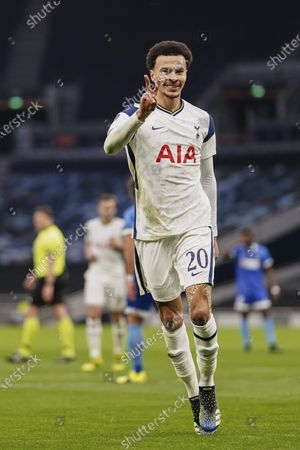 Dele Alli of Tottenham Hotspur celebrates scoring the opening goal