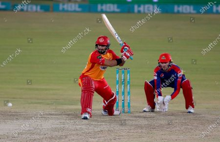 Stock Picture of Islamabad United Hussain Talat, left, plays a shot while Karachi Kings Joe Clarke watches during a Pakistan Super League T20 cricket match between Karachi Kings and Islamabad United at the National Stadium, in Karachi, Pakistan