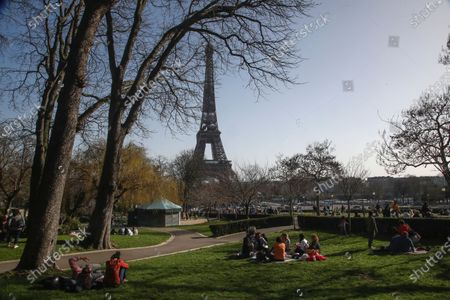 People enjoy the sun at Trocadero gardens near Eiffel Tower in Paris, . France may need to impose new local restrictions to deal with a worsening Covid-19 situation as it scrambles to avoid a new national lockdown, the government spokesman Gabriel Attal told reporters Wednesday