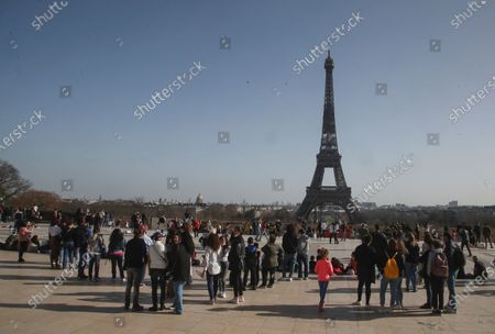 People wearing wearing face masks to prevent the spread of coronavirus gathering at Trocadero plaza near Eiffel Tower in Paris, . France may need to impose new local restrictions to deal with a worsening Covid-19 situation as it scrambles to avoid a new national lockdown, the government spokesman Gabriel Attal told reporters Wednesday