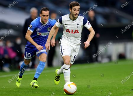 Wolfsberg's Michael Liendl, left, and Tottenham's Harry Winks challenge for the ball during the Europa League round of 32 second leg soccer match between Tottenham Hotspur and Wolfsberger AC at the Tottenham Hotspur Stadium in London, England