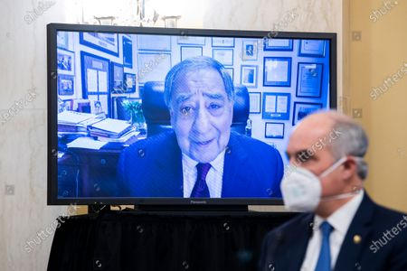 Sen. Bob Casey, D-Pa., right, listens as former CIA Director Leon Panetta, speaks remotely during a Senate Select Intelligence Committee confirmation hearing for William Burns, nominee for Central Intelligence Agency director, on Capitol Hill in Washington