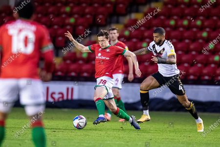 Frank Vincent of Walsall  and Joss Labadie during the EFL Sky Bet League 2 match between Walsall and Newport County at the Banks's Stadium, Walsall