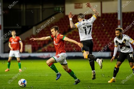 Frank Vincent of Walsall   with Scot Bennett of Newport County during the EFL Sky Bet League 2 match between Walsall and Newport County at the Banks's Stadium, Walsall
