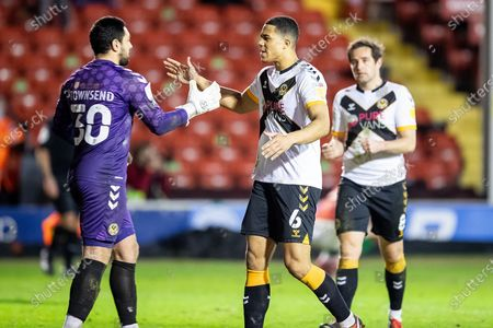 Tom King of Newport County and Priestley Farquharson of Newport County celebrate win after the EFL Sky Bet League 2 match between Walsall and Newport County at the Banks's Stadium, Walsall