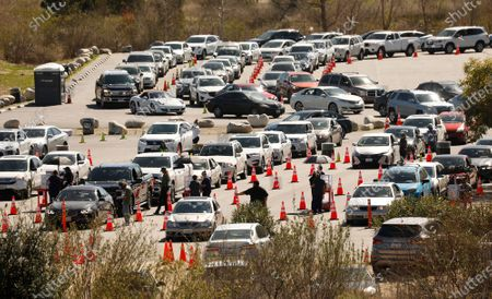 Los Angeles resumes COVID-19 vaccinations Tuesday at the Hansen Dam vaccination site including several other large-scale sites in L.A. that were forced to close late last week when shipments containing at least 63,000 does of COVID-19 vaccines were held up due to a winter storm battering much of the country. COVID-19 vaccinations resume with priority to those who lost appointments. With 92,000 does of the Moderna vaccine arriving in L.A. the city resumed vaccinations. Hansen Dam on Tuesday, Feb. 23, 2021 in Los Angeles, CA. (Al Seib / Los Angeles Times).