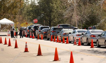 Vehicles line up off Osborne Street as Los Angeles resumes COVID-19 vaccinations Tuesday at the Hansen Dam vaccination site including several other large-scale sites in L.A. that were forced to close late last week when shipments containing at least 63,000 does of COVID-19 vaccines were held up due to a winter storm battering much of the country. COVID-19 vaccinations resume with priority to those who lost appointments. With 92,000 does of the Moderna vaccine arriving in L.A. the city resumed vaccinations. Hansen Dam on Tuesday, Feb. 23, 2021 in Los Angeles, CA. (Al Seib / Los Angeles Times).