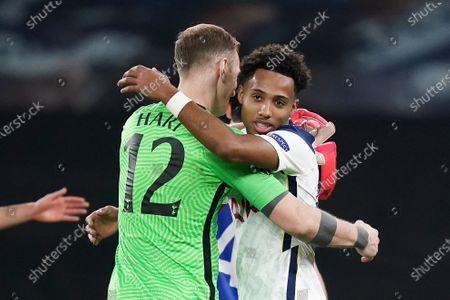 Tottenham's Marcel Lavinier (R) and Tottenham's goalkeeper Joe Hart react after the UEFA Europa League round of 32, second leg soccer match between Tottenham Hotspur and Wolfsberger AC in London, Britain, 24 February 2021.
