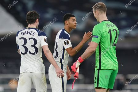 Tottenham's goalkeeper Joe Hart (R), Ben Davies (L) and Dane Scarlett (C) react after the UEFA Europa League round of 32, second leg soccer match between Tottenham Hotspur and Wolfsberger AC in London, Britain, 24 February 2021.