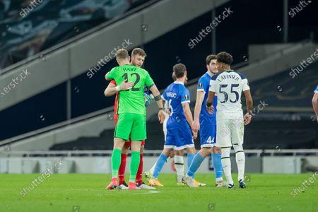 Goalkeeper Joe Hart of Tottenham Hotspur and Goalkeeper Manuel Kuttin of Wolfsberger AC hug at full time