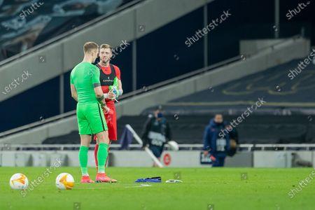 Goalkeeper Joe Hart of Tottenham Hotspur and Goalkeeper Manuel Kuttin of Wolfsberger AC swap shirts at full time