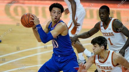 Kansas forward Jalen Wilson (10) is defended by Texas guard Andrew Jones (1) during the second half of an NCAA college basketball game, in Austin, Texas