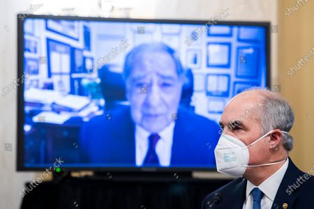 Former CIA Director Leon Panetta, on monitor, makes remarks on behalf of William Burns, nominee for Central Intelligence Agency director, during his Senate Select Intelligence Committee confirmation hearing in Russell Senate Office Building on Capitol Hill in Washington, D.C.,. US Senator Bob Casey, Jr. (Democrat of Pennsylvania), appears at right.