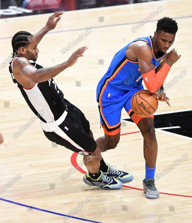 Stock Photo of LOS ANGELES, CALIFORNIA JANUARY 22, 2021-Clippers Kawhi Leonard is called for a blocking foul as Thunders Hamidou Diallo tries to bring the ball upcourt in the 3rd quarter at the Staples Center Friday. (Wally Skalij/Los Angeles Times)