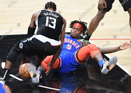 LOS ANGELES, CALIFORNIA JANUARY 22, 2021-Clippers Paul George steals the ball from Thunders Luguentz Dort in the 3rd quarter at the Staples Center Friday. (Wally Skalij/Los Angeles Times)