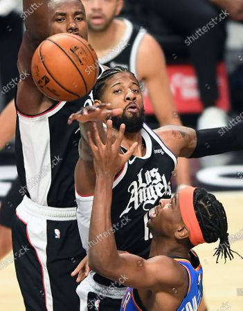 Stock Photo of LOS ANGELES, CALIFORNIA JANUARY 22, 2021-Clippers Paul George tries to block the shot of Thunders Shai Gilgeous-Alexander in the 3rd quarter at the Staples Center Friday. (Wally Skalij/Los Angeles Times)