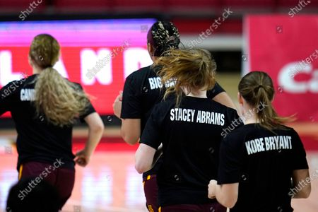 The names of Kobe Bryant and Stacey Abrams, among others, are seen on the back of a t-shirts as members of the Minnesota team warm up prior to an NCAA college basketball game against Maryland, in College Park, Md