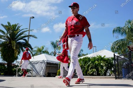 Philadelphia Phillies' Nick Maton leaves after a spring training baseball workout, in Clearwater, Fla
