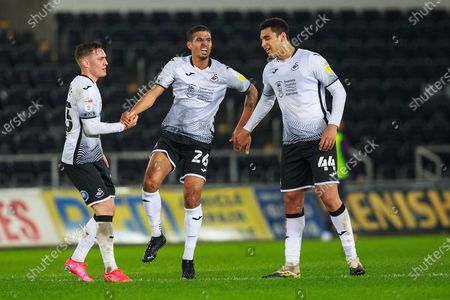 Swansea City defender Connor Roberts (23) and Swansea City defender Benjamin (Ben) Cabango (44) help Swansea City defender Kyle Naughton (26) up during the EFL Sky Bet Championship match between Swansea City and Coventry City at the Liberty Stadium, Swansea