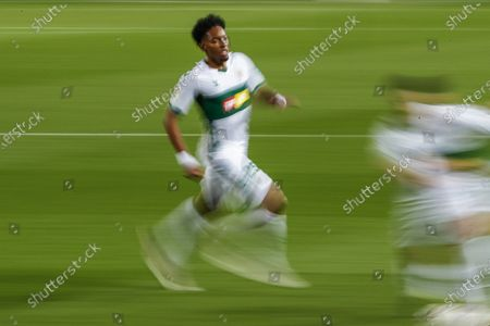 Elche's Johan Mojica runs during the Spanish La Liga soccer match between FC Barcelona and Elche at the Camp Nou stadium in Barcelona, Spain