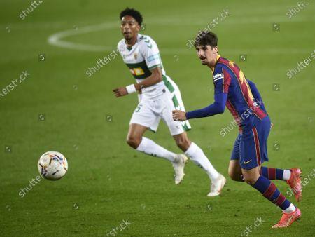 Francisco Trincao of FC Barcelona and Johan Mojica of Elche CF
