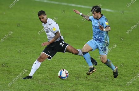 Kyle Naughton of Swansea City is challenged by Gustavo Hamer of Coventry City