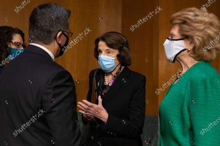 Xavier Becerra (L) speaks with Democratic Senator from California Dianne Feinstein (C) and Democratic Senator from Michigan Debbie Stabenow (R) before the Senate Finance Committee hearing on his nomination to be secretary of Health and Human Services (HHS), on Capitol Hill in Washington, DC, USA, 24 February 2021. If confirmed, Becerra would be the first Latino secretary of HHS.