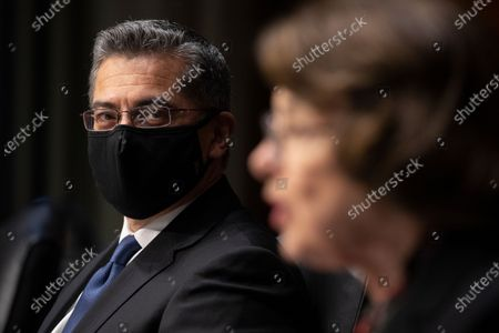 Xavier Becerra listens as Sen. Dianne Feinstein, D-Calif., speaks during a Senate Finance Committee hearing on the nomination of Becerra to be Secretary of Health and Human Services on Capitol Hill in Washington