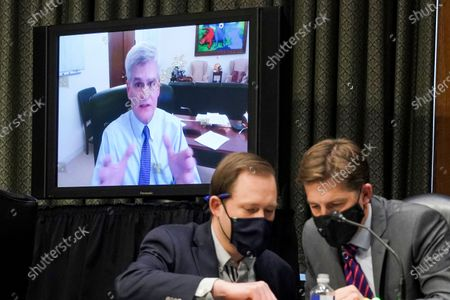 Sen. Bill Cassidy, R-La., speaks remotely during a Senate Finance Committee hearing on the nomination of Xavier Becerra to be Secretary of Health and Human Services on Capitol Hill in Washington, . Sen. Ben Sasse, R-Neb., is at right