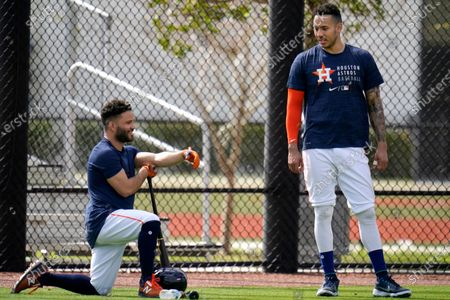 Stock Image of Houston Astros' Carlos Correa, right, talks with teammate Jose Altuve during spring training baseball practice, in West Palm Beach, Fla