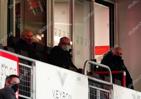 Joe Jordan in the centre watching the game from the stands.