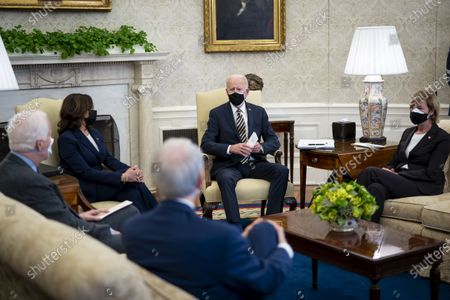 United States President Joe Biden and US Vice President Kamala Harris during a meeting with a bipartisan group of House and Senate members on U.S. supply chains, in the Oval Office,. From left to right: US Senator Rob Portman (Republican of Ohio), US Senator John Cornyn (Republican of Texas), US Vice President Kamala Harris, President Biden, and US Senator Tammy Baldwin (Democrat of Wisconsin).