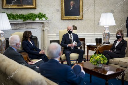Stock Photo of United States President Joe Biden and US Vice President Kamala Harris during a meeting with a bipartisan group of House and Senate members on U.S. supply chains, in the Oval Office,. From left to right: US Senator Rob Portman (Republican of Ohio), US Senator John Cornyn (Republican of Texas), US Vice President Kamala Harris, President Biden, and US Senator Tammy Baldwin (Democrat of Wisconsin).