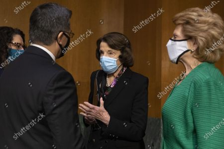 Xavier Becerra (L) speaks with Democratic Senator from California Dianne Feinstein (C) and Democratic Senator from Michigan Debbie Stabenow arrive before the Senate Finance Committee hearing on the nomination of Xavier Becerra to be secretary of Health and Human Services (HHS), on Capitol Hill in Washington, DC on February 24, 2021. If confirmed, Becerra would be the first Latino secretary of HHS.