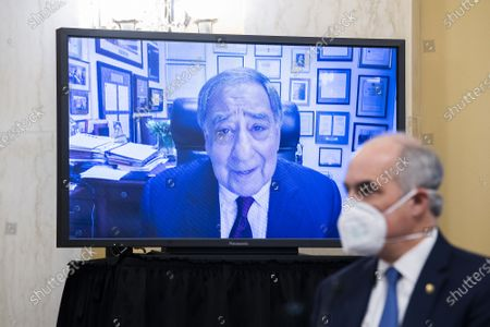 """Stock Photo of Former CIA Director Leon Panetta, on monitor, makes remarks on behalf of William Burns, nominee for Central Intelligence Agency director, during his Senate Select Intelligence Committee confirmation hearing on """"Legislative Proposals to Put the Postal Service on Sustainable Financial Footing"""" on Capitol Hill"""