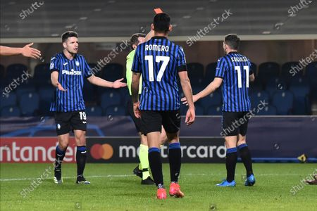 Stock Photo of Referee Tobias Stieler of Germany shows the red card to Atalanta's Remo Marco Freuler during the UEFA Champions League soccer match, round of 16, first leg, Atalanta BC vs Real Madrid at Gewiss Stadium in Bergamo, Italy, 24 February 2021.