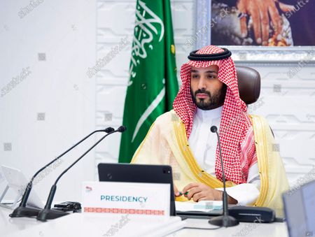 """Saudi Arabia's Crown Prince Mohammed bin Salman attends a virtual G-20 summit held over video conferencing, in Riyadh, Saudi Arabia. Saudi Arabia's royal court says Crown Prince Mohammed bin Salman underwent a """"successful surgery"""" for appendicitis on Wednesday, Feb. 24, 2021, and left the hospital soon after the operation. The 35-year-old Prince Mohammed had laparoscopic surgery at the King Faisal Specialist Hospital in the Saudi capital of Riyadh in the morning"""