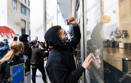 Protestors bang on the windows outside the offices of New York Attorney General Letitia James during a Black Lives Matter protest in response to yesterday's news that the Rochester, New York police officers involved in last year's death of Daniel Prude will not be indicted in New York, New York, USA, 24 February 2021. Prude died on 23 March 2020 after police officers responded to the house where he was staying, handcuffed him and placed him a mesh hood over his head, reportedly in response to Prude spitting. Prude stopped breathing on the scene, was resuscitated by paramedics but died in the hospital a week later.
