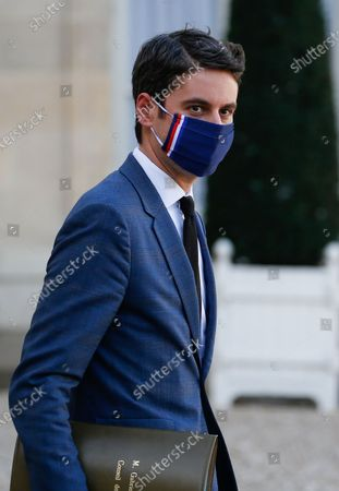 French Secretary of State and Government's spokesperson Gabriel Attal looks on as he leaves the weekly cabinet meeting at the Elysee presidential palace
