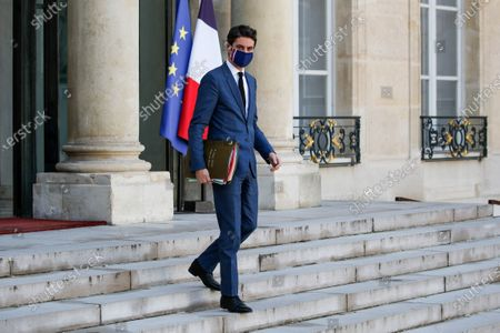 French Secretary of State and Government's spokesperson Gabriel Attal leaves the weekly cabinet meeting at the Elysee presidential palace