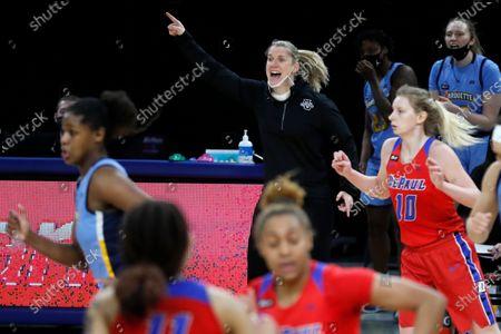 Marquette head coach Megan Duffy directs the team during the second half of an NCAA college basketball game against DePaul, in Chicago