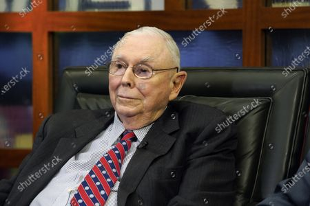 """Berkshire Hathaway Vice Chairman Charlie Munger listens to a question during an interview in Omaha, Neb., with Liz Claman on Fox Business Network's """"Countdown to the Closing Bell."""" Investor Warren Buffett's right-hand man, Munger, says the U.S. stock market is overvalued, but he doesn't know when the bubble will burst. Munger said Wednesday, Feb. 24, 2021, that the recent frenzy over GameStop's stock was driven by small investors gambling on the stock market"""