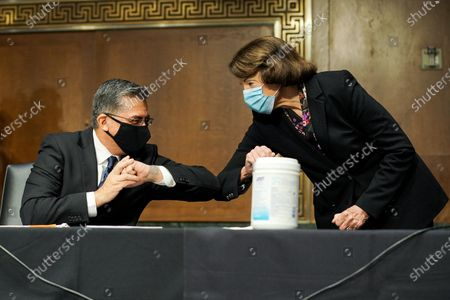 Xavier Becerra, nominee for Secretary of Health and Human Services, elbows bumps United States Senator Dianne Feinstein (Democrat of California) during his Senate Finance Committee nomination hearing at Capitol Hill in Washington, D.C.