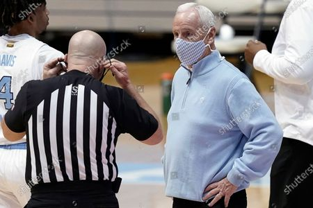 North Carolina coach Roy Williams speaks with an official during the second half of the team's NCAA college basketball game against Marquette in Chapel Hill, N.C
