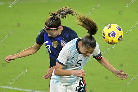 United States forward Alex Morgan (13) and Argentina midfielder Vanesa Santana (5) compete for a header during the second half of a SheBelieves Cup women's soccer match, in Orlando, Fla