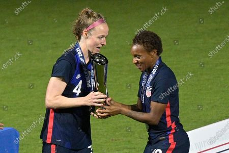 United States defenders Becky Sauerbrunn (4) and Crystal Dunn (19) hold the championship trophy after a SheBelieves Cup women's soccer match against Argentina, in Orlando, Fla
